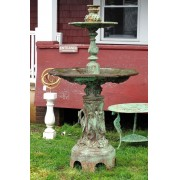 Cast iron three part fountain with bird motif on base.