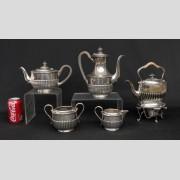 Sterling silver five piece tea set.