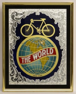 "19th c. Schwinn sign ""The World"", reverse painted on glass"