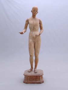 19th c. wooden mannequin on platform
