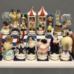 "Hand molded and painted ceramic ""Circus"" chess set by Doug Anderson (b. 1957)."