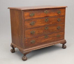18th c. New York mahogany ball and claw foot chest of drawers.