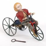 11. Stevens Brown Girl On Velocipede Toy