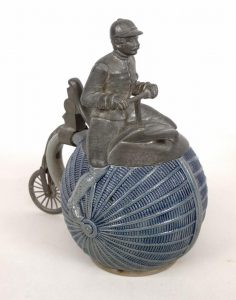 Rare figural pewter top figural high wheel rider stein