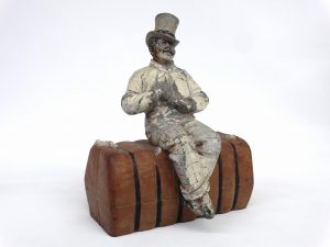 Doorstop, Man On Bale Of Cotton, unknown foundry, C. 1920