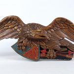 Carved and painted wooden eagle wall plaque.