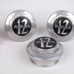 "333. Lot (3) Auburn 12 hub caps. 3 1/4"" fitting."