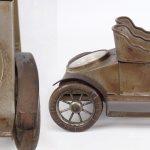 """76. Rare figural automobile clock. 8 3/4"""" L.."""