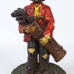 "C. 1940-50 cast iron Clown doorstop. Depicts Emmet Kelly, aka ""Weary Willy"""