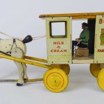 Early Borden's wood and pressed tin horse drawn wagon