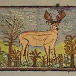 C. 1900's deer hooked rug