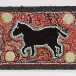 Hooked rug, horse on multicolored background.