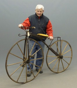 "c. 1865 boneshaker, maker unknown 38 1/2"" front, 32 3/4 rear wooden spoked wheels with metal band tires, retains saddle (wood base horsehair with worn leather cover), brakes, pedals."