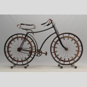 C. 1888 hard tire safety bicycle. Features unusual, possibly unique engineered
