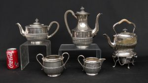 Sterling silver five piece tea set.