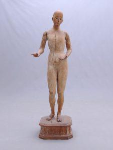 19th c. wooden mannequin on platform