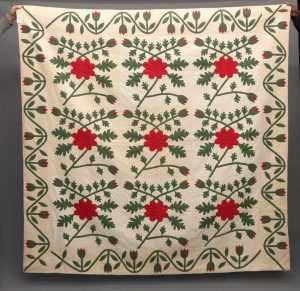 19th c. red, green and white applique quilt.