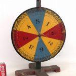 Early 20th c. table top polychrome painted wood game wheel.