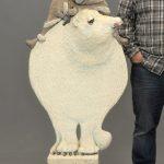 "Mixed media ice fisherman and polar bear sculpture. 49 1/2"" Ht.."