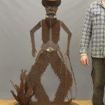 "Contemporary folk sheet metal cowboy and cactus. 33"" x 17"" x 57"" Ht.."