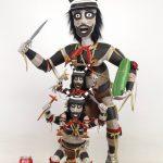 "Contemporary Hopi clown folk art Kachina grouping. Polychrome painted wood. 39 1/2"" Ht.."