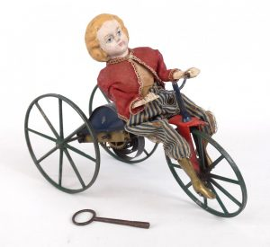 Stevens Brown Girl On Velocipede Toy