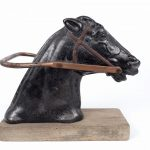 Lot 13. C. 1910 cast iron carousel horse head. Attributed to C. W. Parker, Kansas
