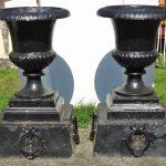 Lot 81. Pair of 19th c. cast iron urns