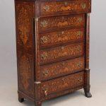 Lot 90. 19th c. Dutch inlaid six drawer chest.
