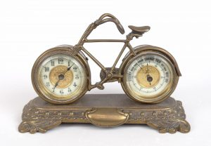 """98. C. 1900's brass bicycle barometer / clock combination. 7 1/2"""" W.."""