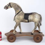 Early wooden painted platform horse