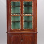 18th c. four door English mahogany two part Chippendale corner cupboard
