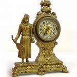 C. 1890's cast metal figural tennis player mantle clock