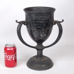 "251. Early automobile trophy ""AUTOMOBILE TROPHY 1st Prize / FREE FOR ALL / WON BY / JAMES BLAINE WORCESTER / OCT. 29, 1910""."