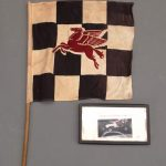 86. Pegasus Checkered flag. Includes photograph of Burt Brooks in the Hennessey owned Offy midget in 1962.