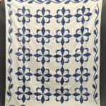 19th c. blue and white quilt with vine border.