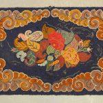 C. 1900 floral hooked rug