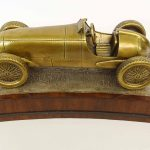 Brass sculpture of early race car in Brooklands Banking