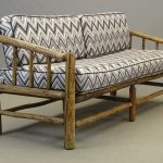 Adirondack log settee with cushions