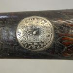 Early long gun with King Phillip coin inlaid by headstock
