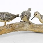 "Painted wooden shorebird group marked ""H. MONK"""