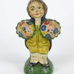 C. 1920 cast iron Colonial man with boquets doorstop.