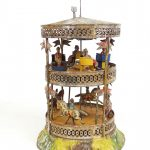 C. 1900 tin windup Gutherman Merry-Go-Round toy.