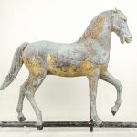 Full bodied horse weathervane in verdigris patina with traces of gold.